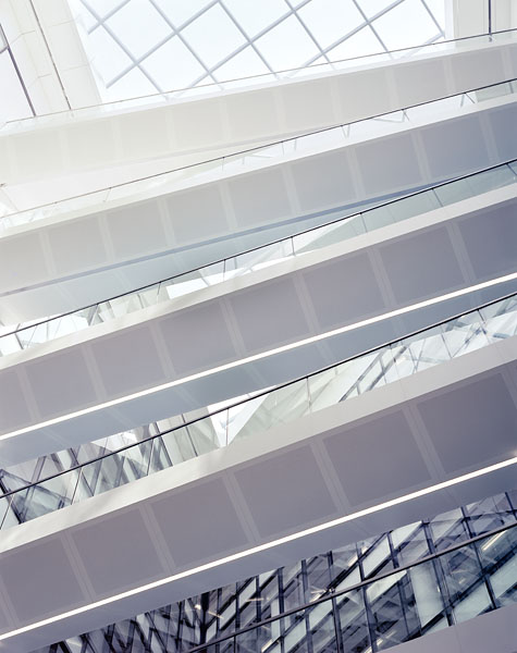Looking up into the atrium at the white-clad bridges.2/18
