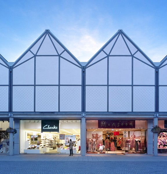 Elevation of shops showing traditionally rendered facade.4/13