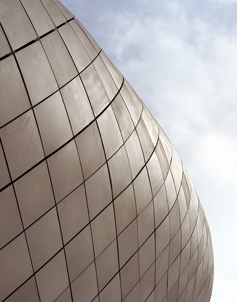 Close view of Debenhams showing the material quality of the metal cladding.10/13