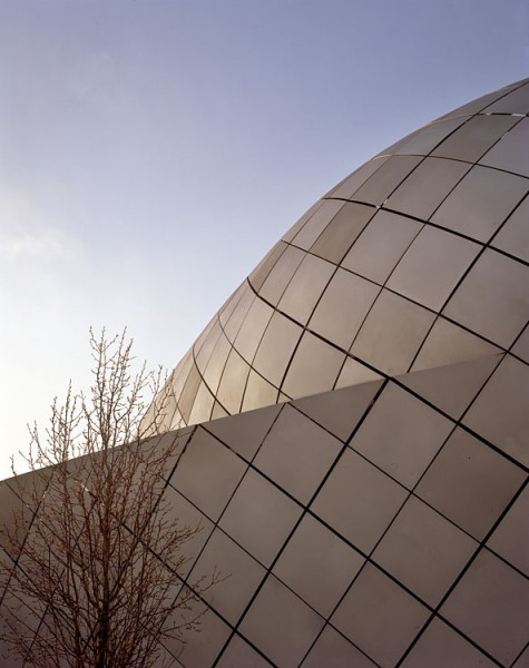 Close view of Debenhams showing the material quality of the metal cladding.11/13