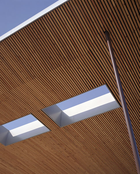 Detail of the entrance canopy showing timber soffit and lights. 12/41