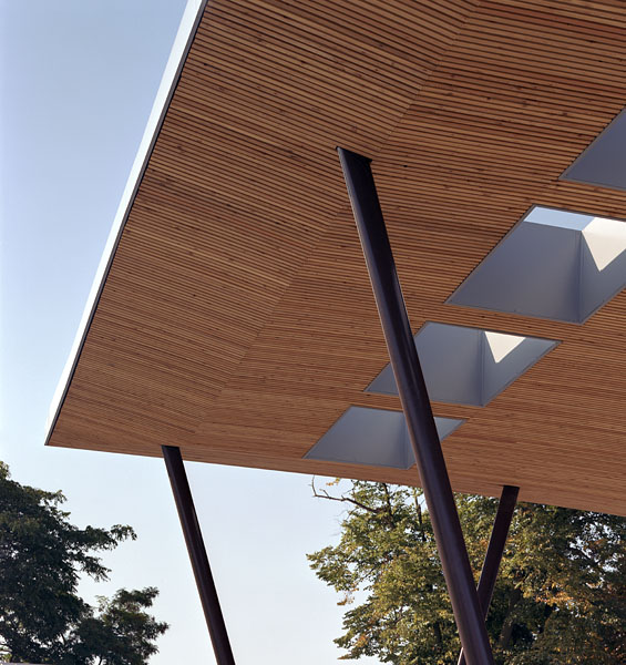 Detail of the entrance canopy showing timber soffit and lights, alternative view. 13/41