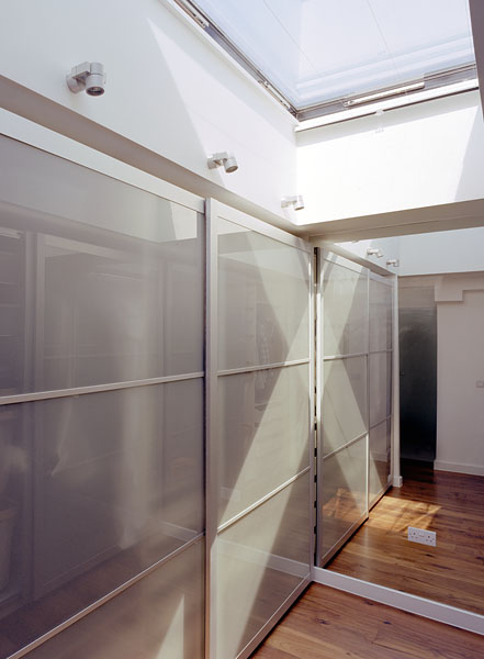 Walk-in wardrobe with roof light.13/18