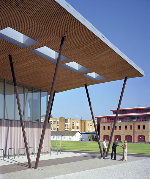 Forecourt, entrance canopy and sports field beyond. 14/41