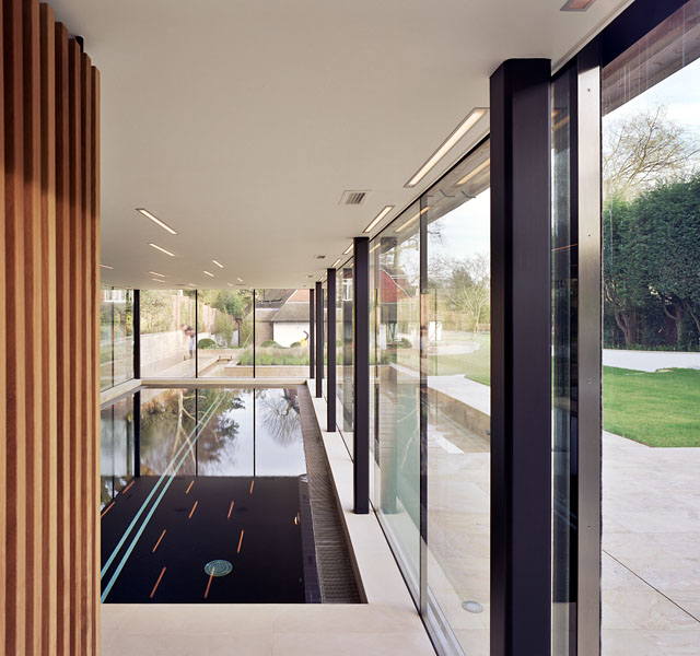 Pool House in Kingston-upon-Thames by Coup De Ville Architects: internal view showing timber cladding.14/65
