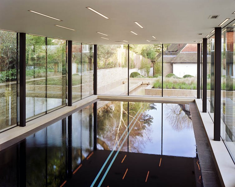 Pool House in Kingston-upon-Thames by Coup De Ville Architects: internal view showing glazing and pool.15/65