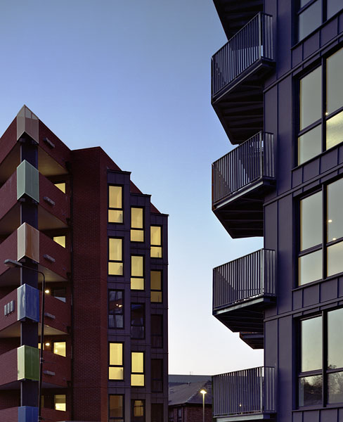 International House in Woolwich, London, by Alan Camp Architects: exterior view at dusk.19/65