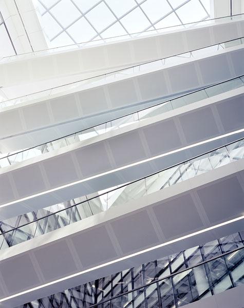 Regents Palace Hotel, Regents Street, London, by Dixon Jones Architects: looking up into the atrium at the white-clad bridges.21/48