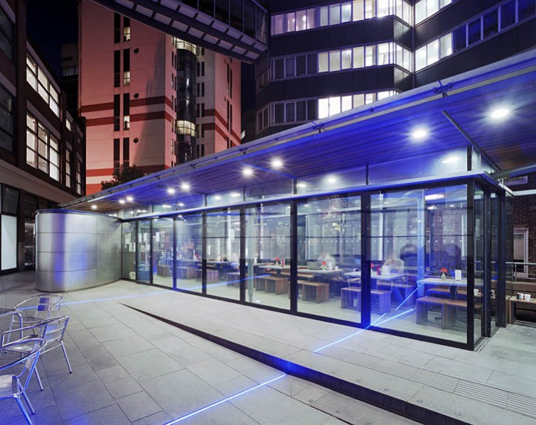 Cafe at John Watkins Plaza, LSE, London, bu MJP Architects: exterior night view.27/48