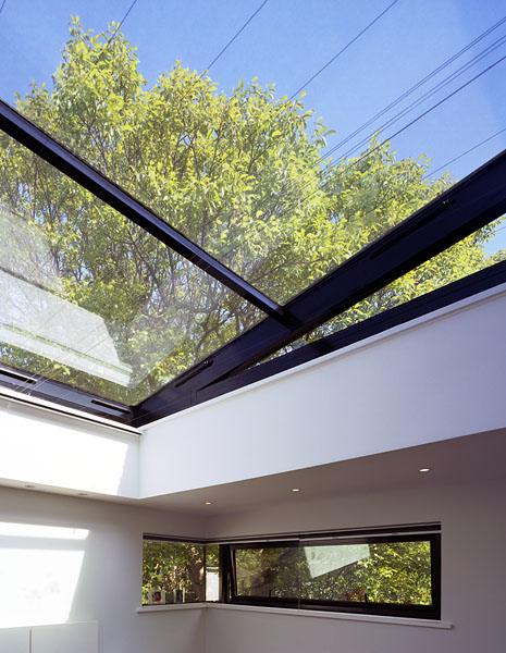 Private residence in Blackheath, London, by Alan Camp Architects: bedroom with large roof light and corner glazing.29/65