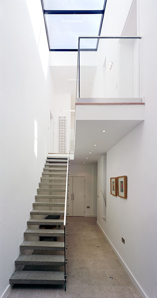 Private residence in Blackheath, London, by Alan Camp Architects: staircase and hall with roof light.33/65