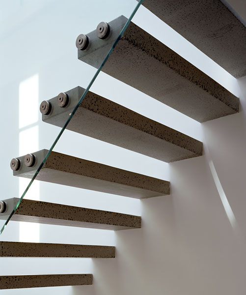Private residence in Blackheath, London, by Alan Camp Architects: staircase with concrete steps and cantilevering balustrade.36/65