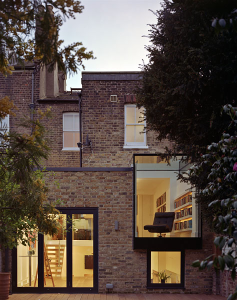 Private residence in Twickenham by Coup De Ville Architects: garden elevation at dusk.45/65