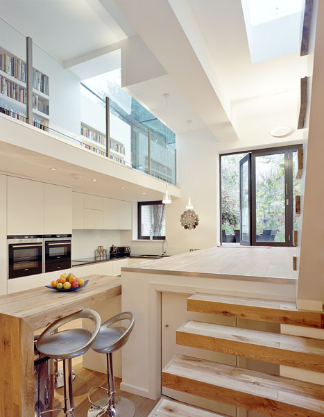 Private residence in Twickenham by Coup De Ville Architects: the kitchen and library.47/65