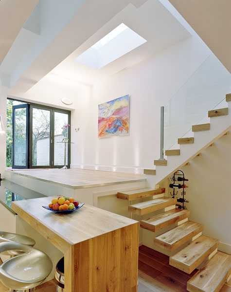 Private residence in Twickenham by Coup De Ville Architects: the kitchen and staircase.48/65