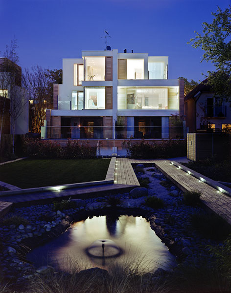 Private residence in Waldegrave Rd, Twickenham by Coup De Ville Architects: rear elevation and landscaped garden.51/65