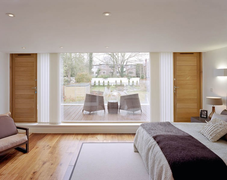Private residence in Waldegrave Rd, Twickenham by Coup De Ville Architects: bedroom overlooking garden.52/65