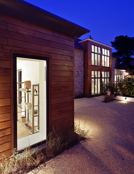 Private residence in London by Coup De Ville Architects: external view at dusk.55/65