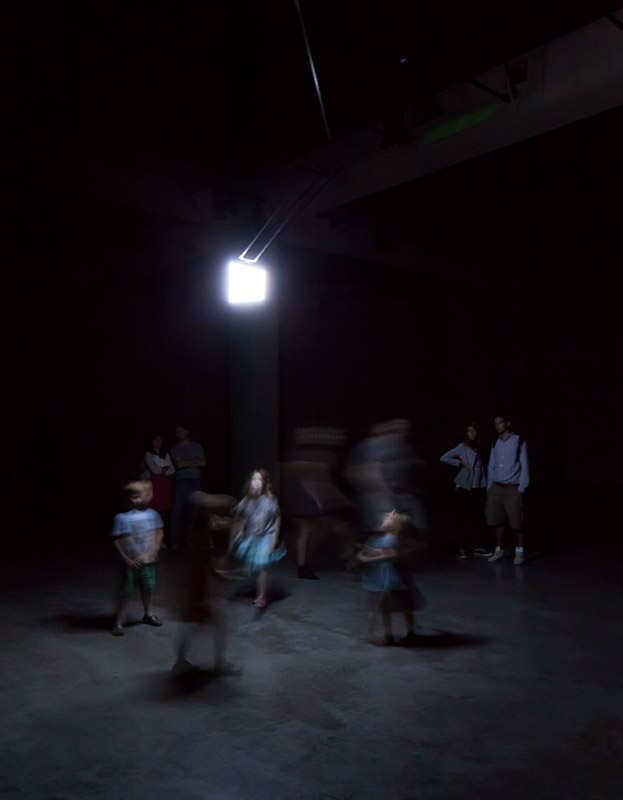 children dancing with installation