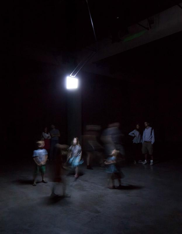 children dancing with installation