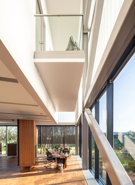 Interior photograph looking up towards a double height space. 9 of 12