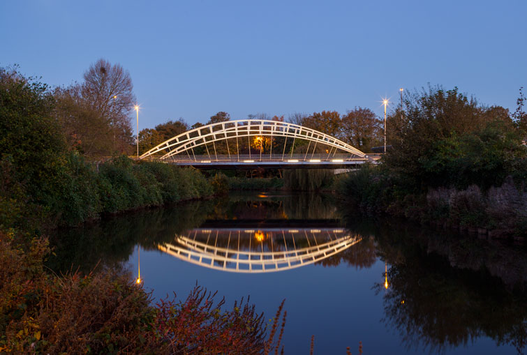 Lit bridge reflected in the canal as sun sets. 13 of 16