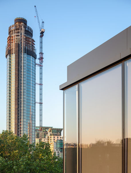 Detail photograph of Roof junction glazing with Nine Elms redevelopment in the near distance. 12 of 12
