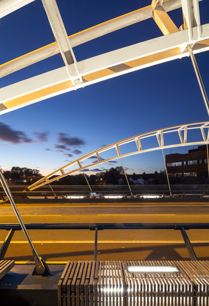 Night time photograph of bridge lighting and timber panelling. 15 of 16