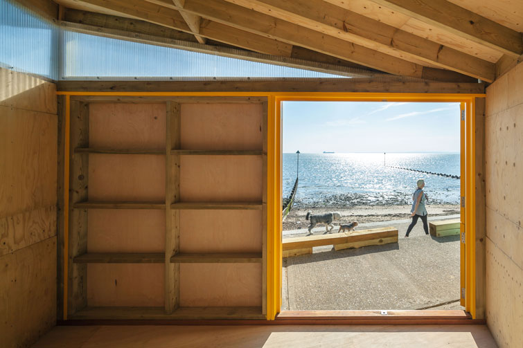 Interior photography showing view of sea. 3 of 12