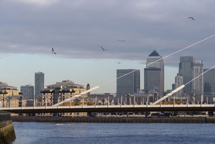 Cable stayed footbridge photographed against Docklands. 2 of 15.
