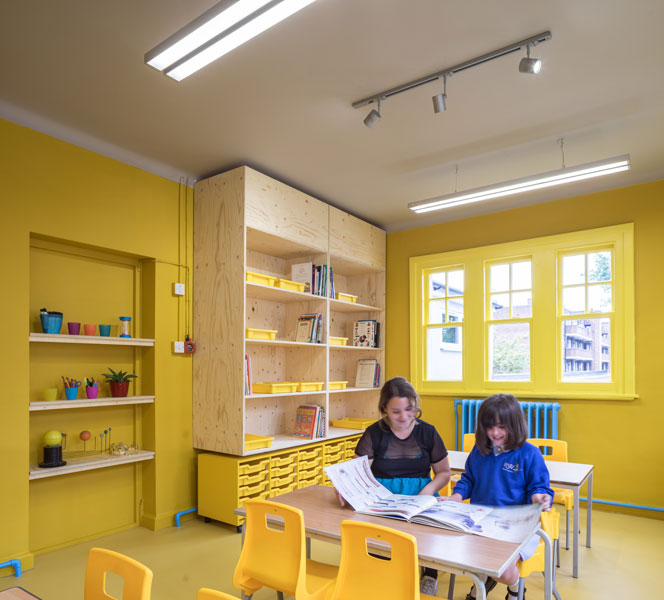 Photograph of classroom with yellow colour scheme. 5 of 14.