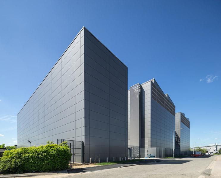 Rear view showing metal-clad facades, 02 of 09