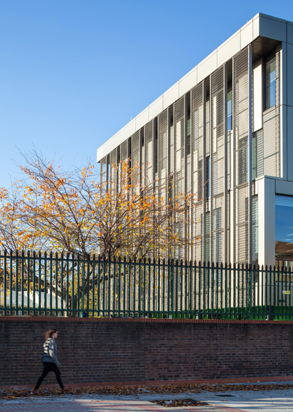 School with metal cladding showing relationship to street, 02 of 24