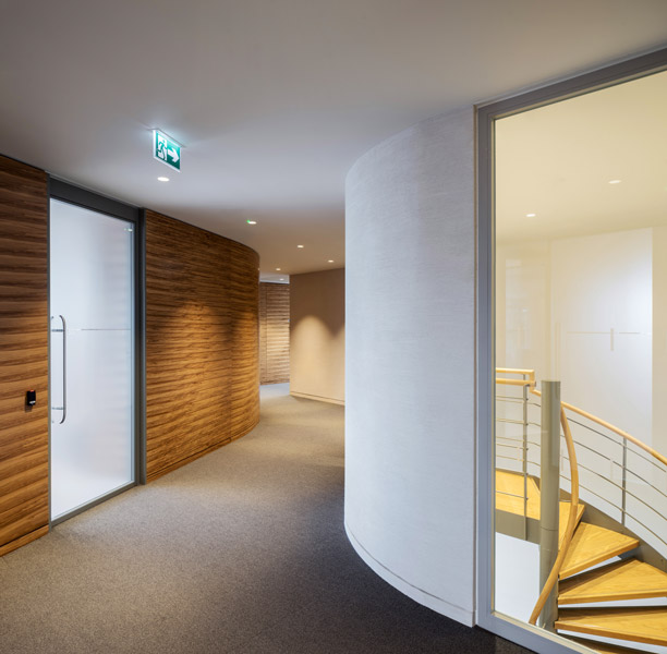 Corridor with veneer panels and view of the spiral staircase, 05 of 14