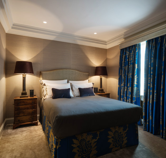 Bedroom interior showing bespoke fabric clad bed, 08 of 18