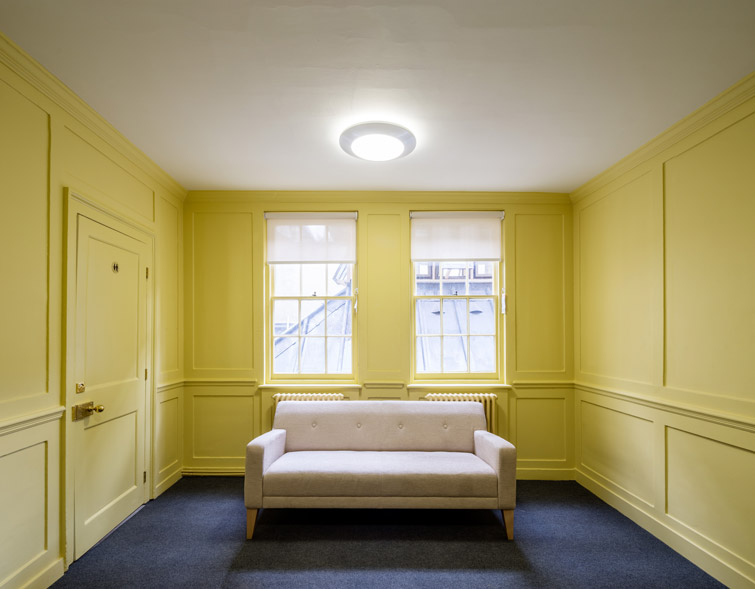 Interior showing yellow timber panels, 10 of 12