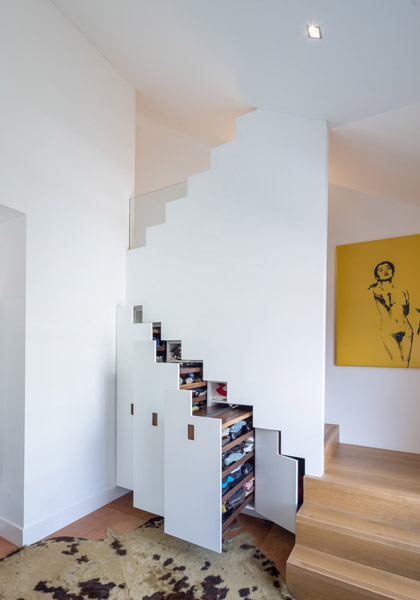 Staircase featuring storage and leather floor, 15 of 17