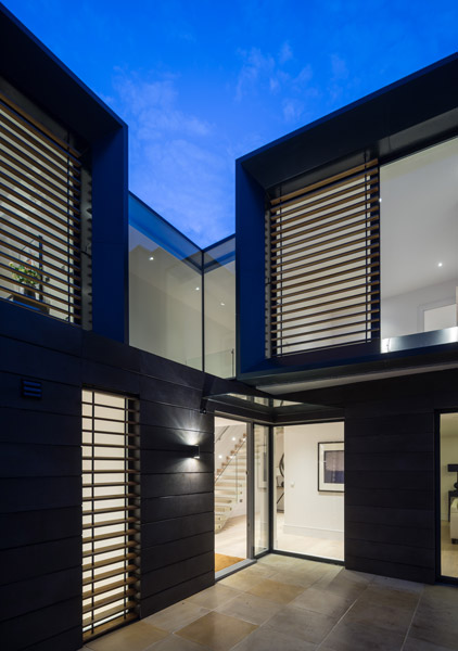Night view of exterior showing external shading, 17 of 24