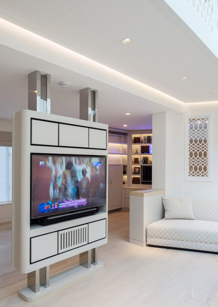 Photograph of the bespoke interior, showing TV holders, 03 of 19