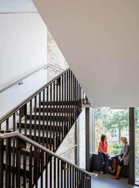The staircase architecture incorporates informal meeting areas, 19 of 26.