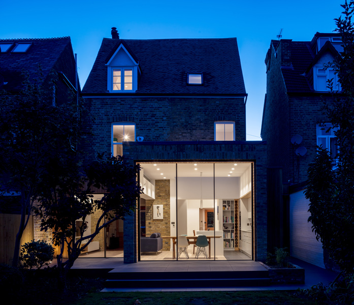 Dusk photograph of residential extension by Moxon Architects, 33 of 40