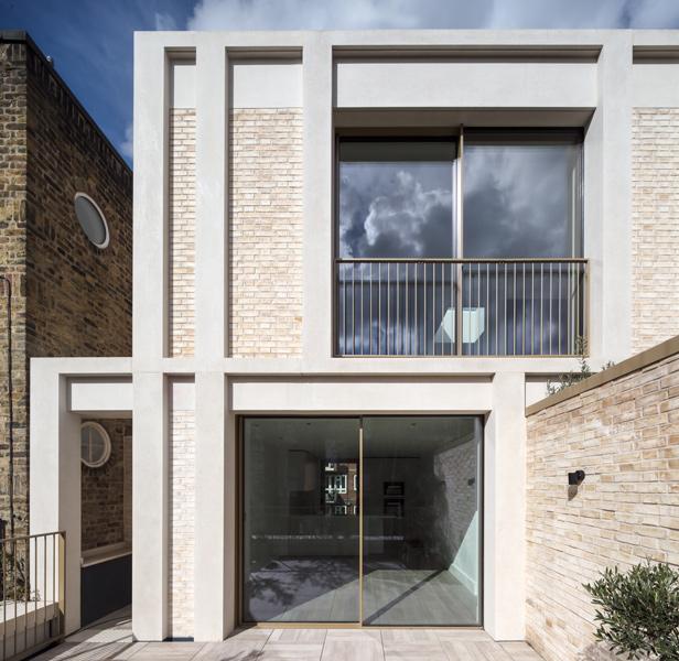 "Exterior facade planes with brick, minimalist glazing and precast ""stone"", 01 of 15."