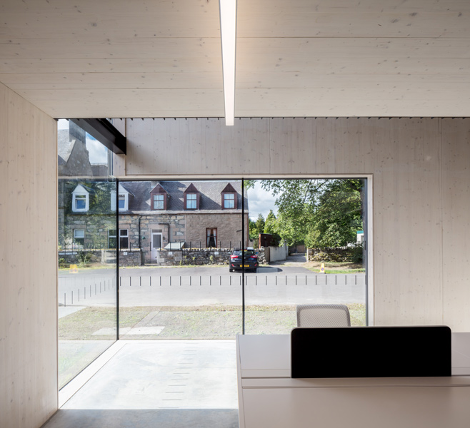 Interior featuring timber panelling and minimally-framed glazing, 02 of 16.