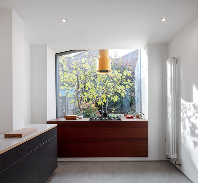 Interior view of kitchen with white walls and-large glazed opening, 02 of 08.