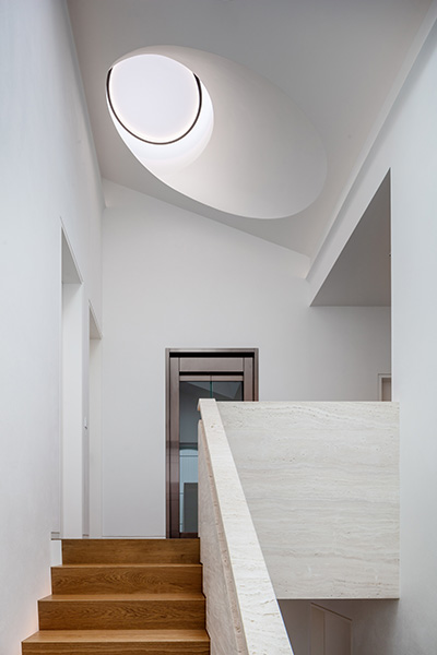 Sculptural rooflight at the top of the stairs floods the space with light, 02 of 20.