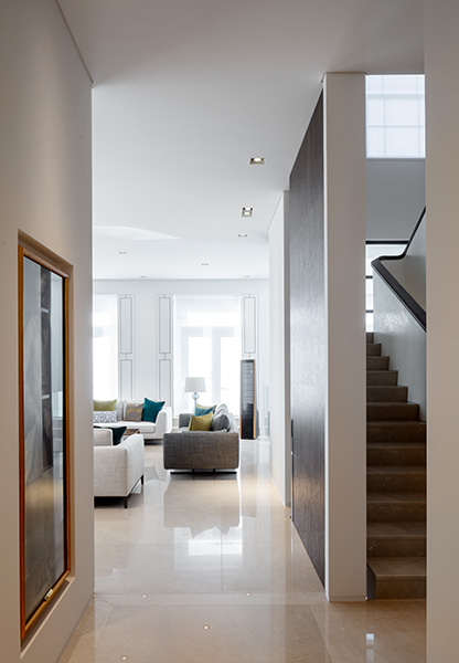 Entrance to living room showing stone staircase, 03 of 11.