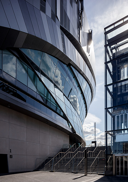 Exterior photograph showing complex sculptural glazing and steel handrails, 03 of 07.