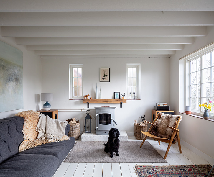 Interior featuring modernist furniture and white painted wood, 03 of 06.