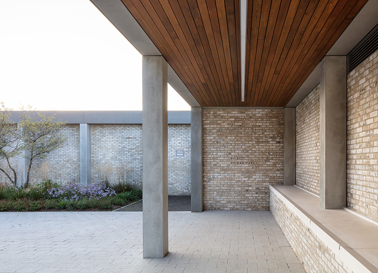 The colonnade features timber soffit and exquisitely detailed brick and pre cast concrete, 03 of 21.