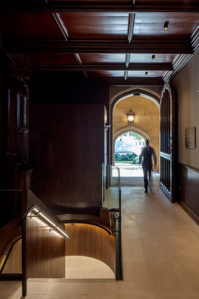 A beautifully-detailed staircase insertion complements the historic architecture, 04 of 07.